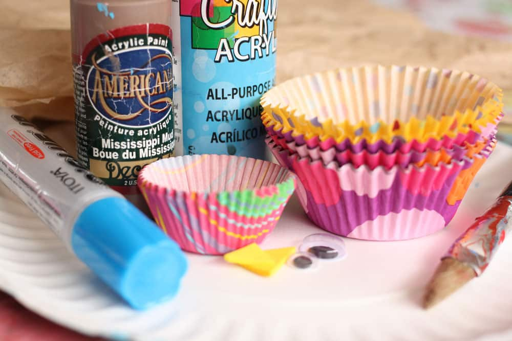Two bottles of acrylic craft paint (brown and blue) brown tissue paper & Paper Plate Birds-in-a-Nest Craft | Play | CBC Parents
