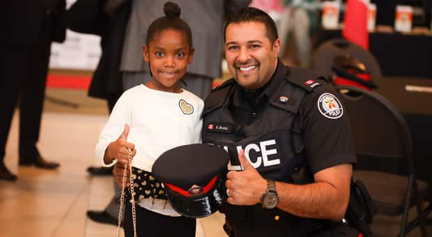 Little girl with police officer