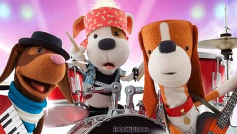 Bookaboo on the drums with his puppy pals!