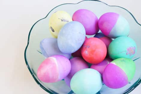 A bowl of colourful eggs.