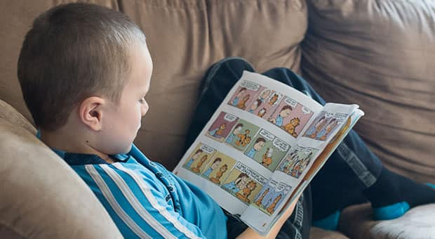 child reads comic book