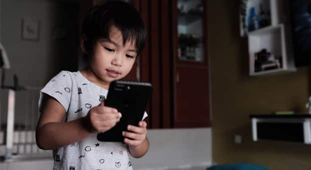 A boy uses a smartphone
