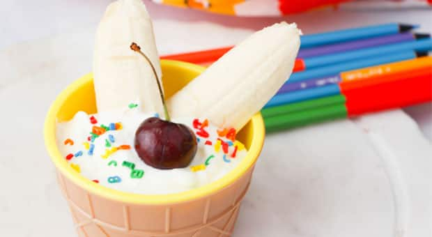 A back-to-school sundae made with yogurt, a banana, a fresh cherry and alphabet sprinkles.