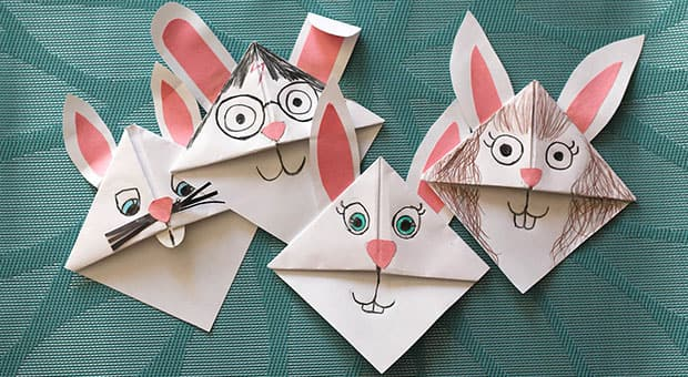 Folded corner bookmarks with cute bunny faces.