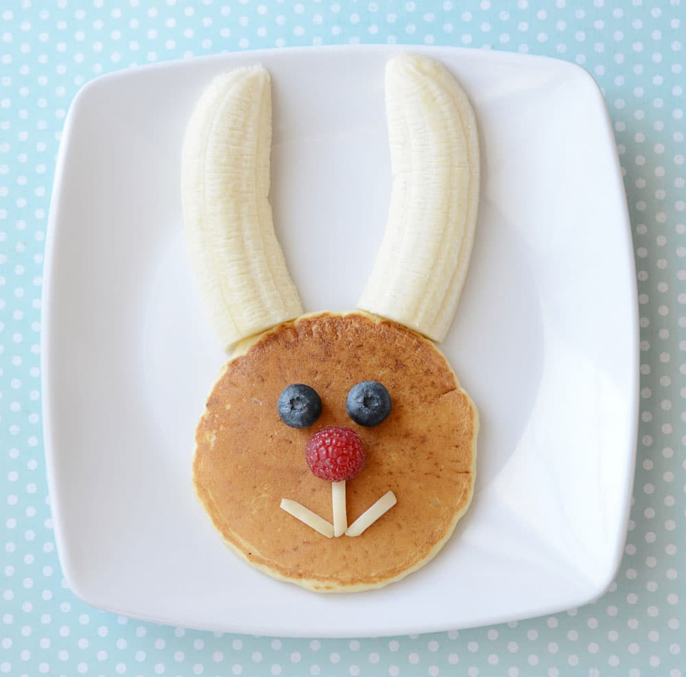 Pancake bunny head with banana ears, blueberry eyes, raspberry nose and slivered almond mouth.