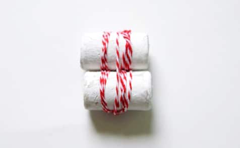 Two white corks tied together with twine.