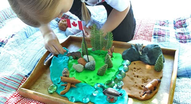 A girl plays with a Canada-themed play dough set.