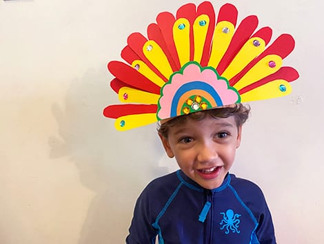 little boy with completed headpiece on