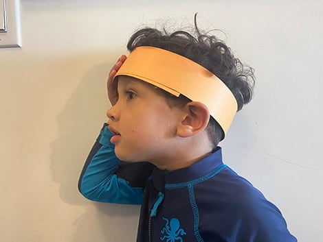 fitting the two inch band on child's head