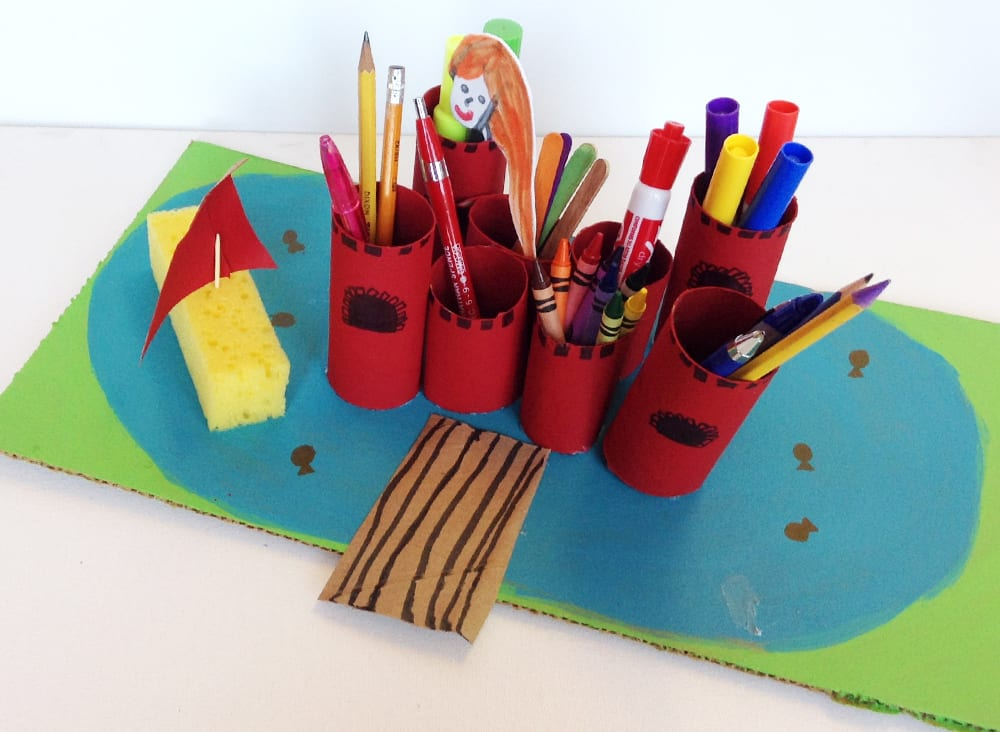 A finished castle desk organizer full of drawing and writing supplies.