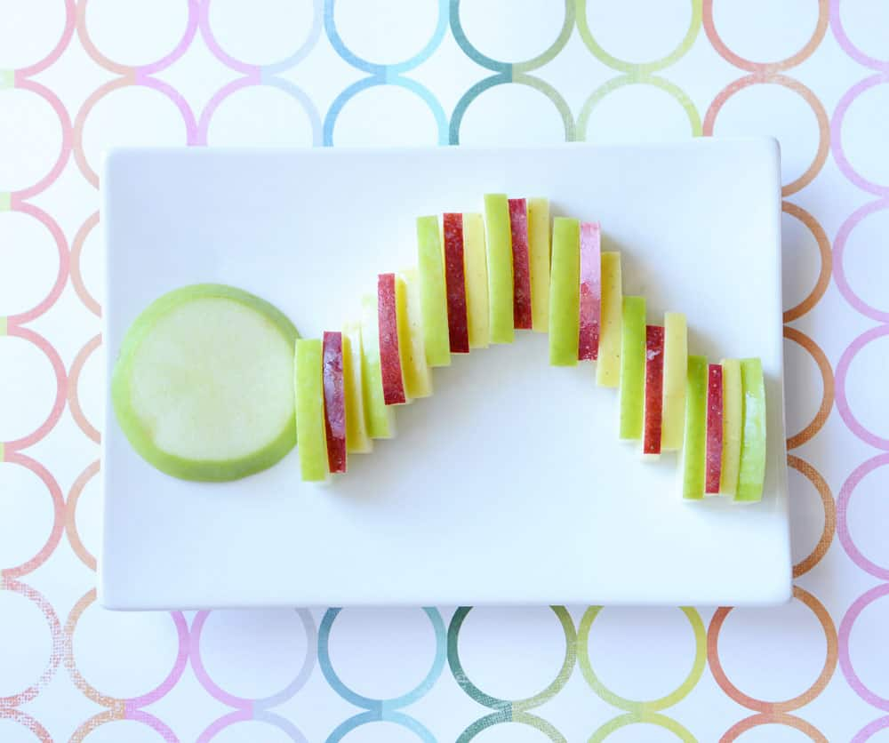 Apple slices in the shape of a caterpillar.