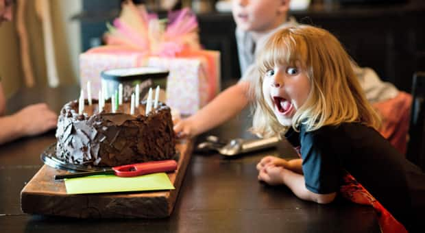 a young girl happily celebrates her birthday