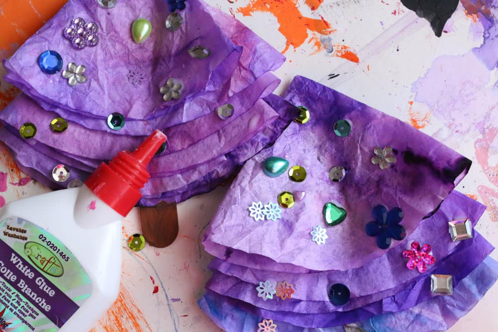 Purple coffee filter Christmas trees covered with craft gems.