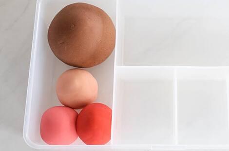 Colourful play dough balls.