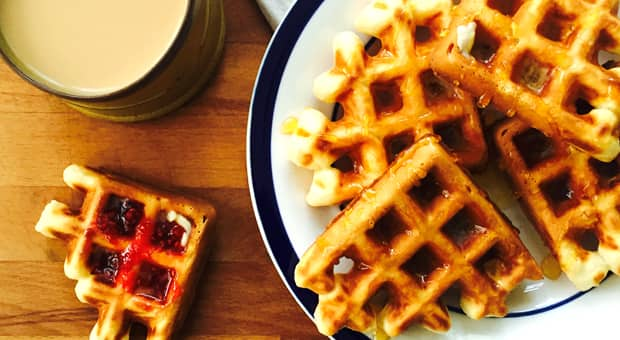 Waffles with maple syrup and jam.