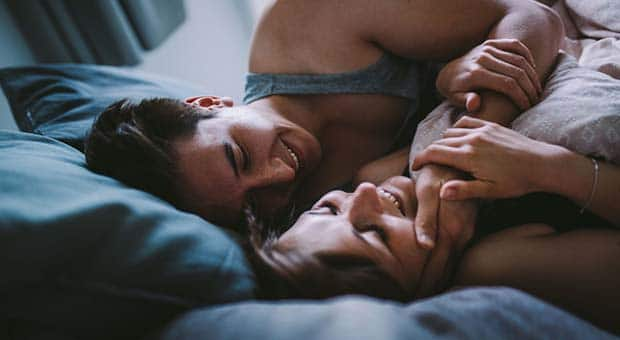 A couple intimate in bed
