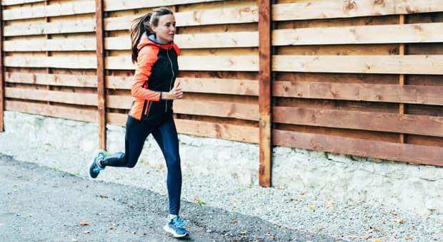 woman running a marathon looking tired