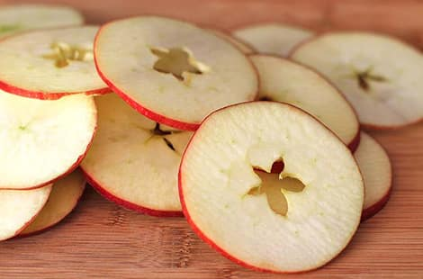 Cored and sliced apples.