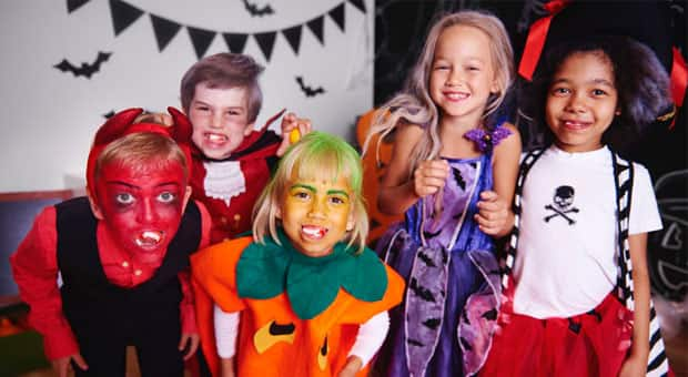 A group of kids dressed up for halloween.