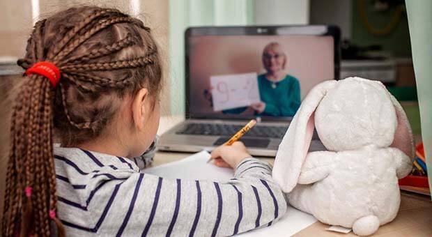 School girl doing online learning