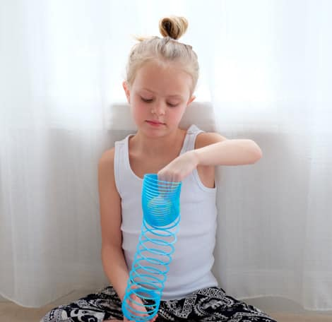 A child stretching out a plastic slinky.