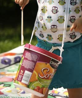 A drum made out of an ice cream tub.