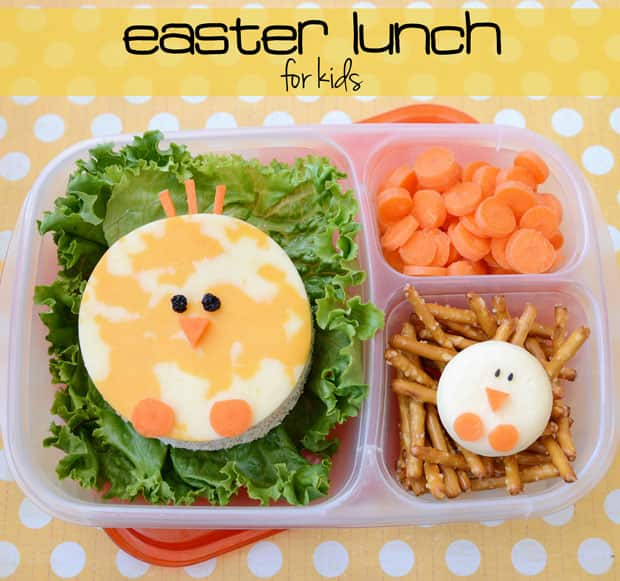 A school lunch with a sandwich that looks like a chick.