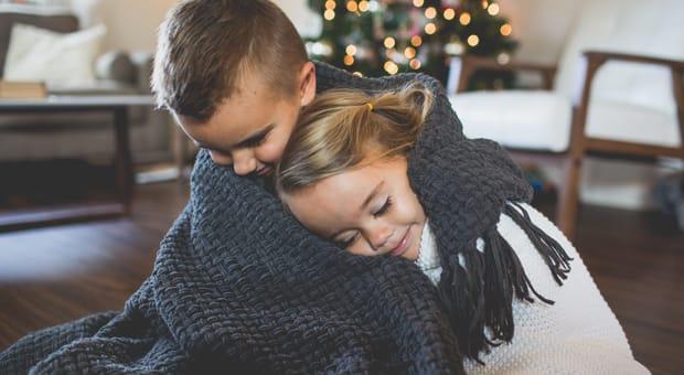 young children enjoy a Christmas morning