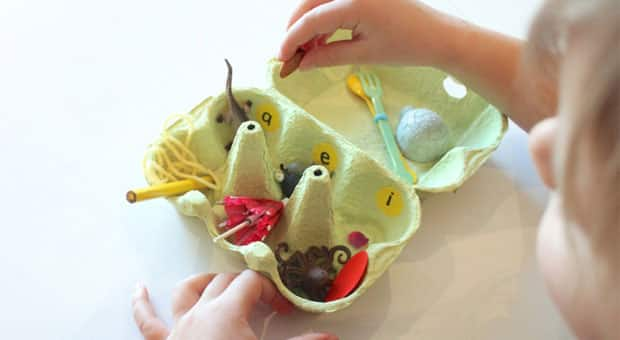 an egg carton with small objects inside