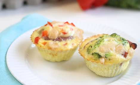 Egg cups that have been baked in muffin cups. They contain broccoli, red pepper, potatoes and bacon.