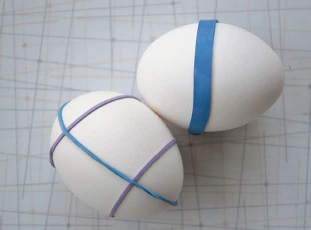 Hard-boiled eggs wrapped in elastic bands.