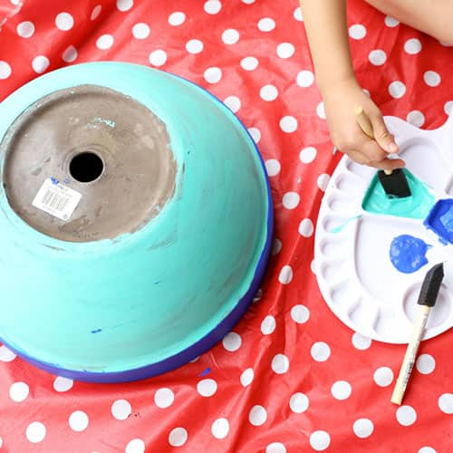 A pot painted turquoise.