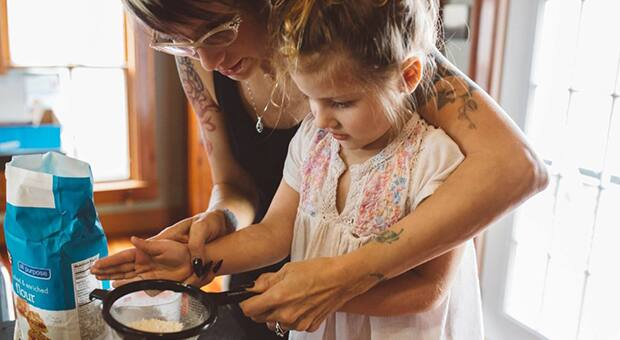 Woman bakes with her daughter