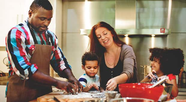 Family cooking together in kitchen.