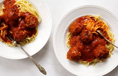 Two bowls of spaghetti and meatballs.
