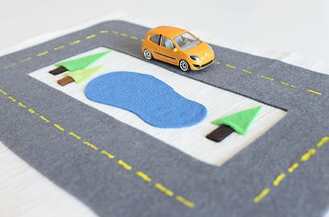 Felt race track with a mini-car.