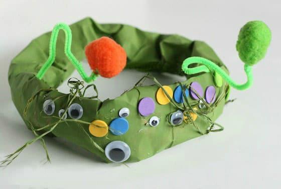 A finished green paper bag monster hat.