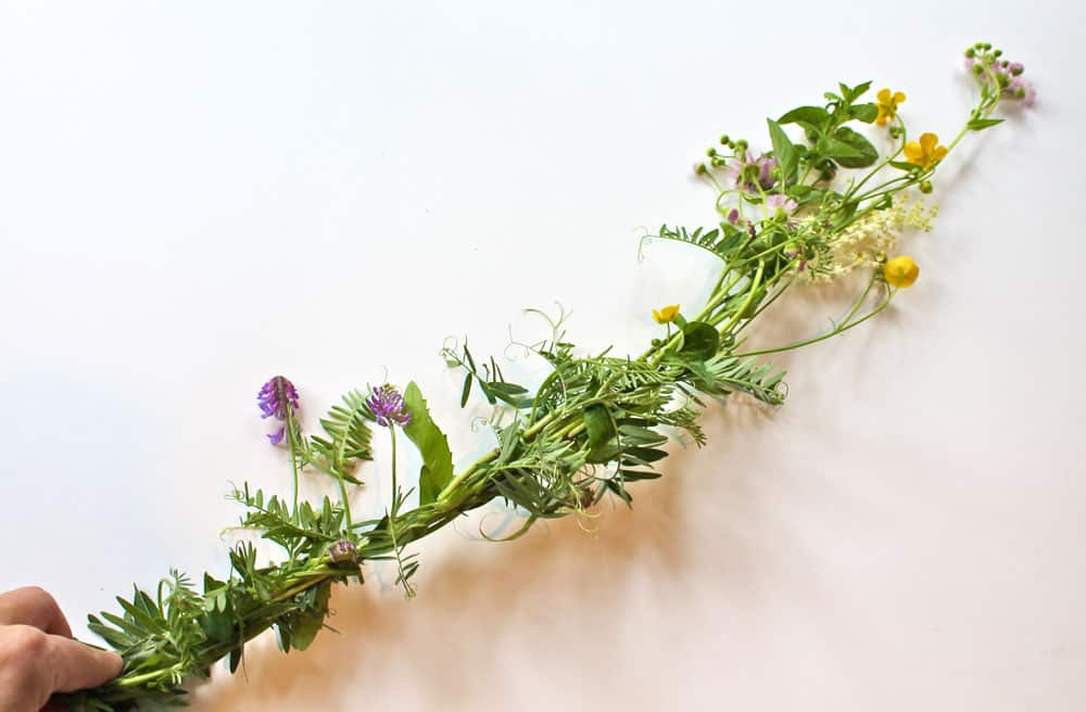 A string of wildflowers, woven together.