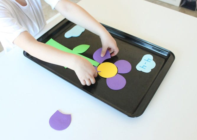 Child playing with the magnetic flower subtraction game.