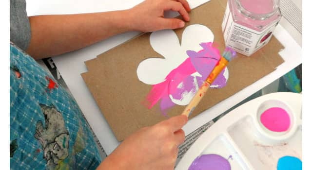 A flower stencil made out of cardboard.