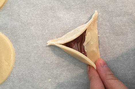 Folding corners of the cookie.