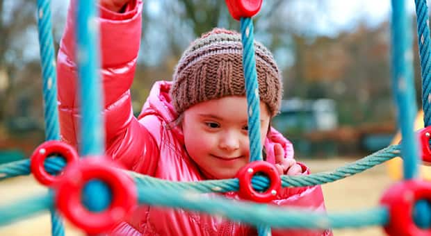 Child playing on outdoor playground by herself