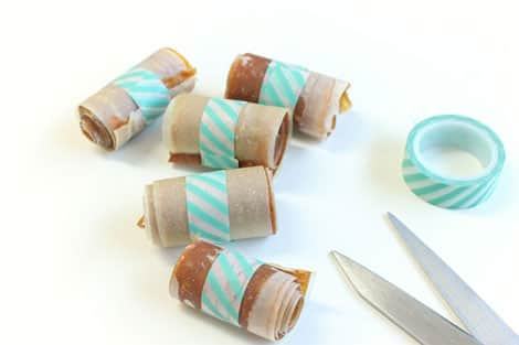 Rolls of fruit leather fastened with decorative washi tape.