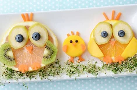 An owl and chickadee made from fruit