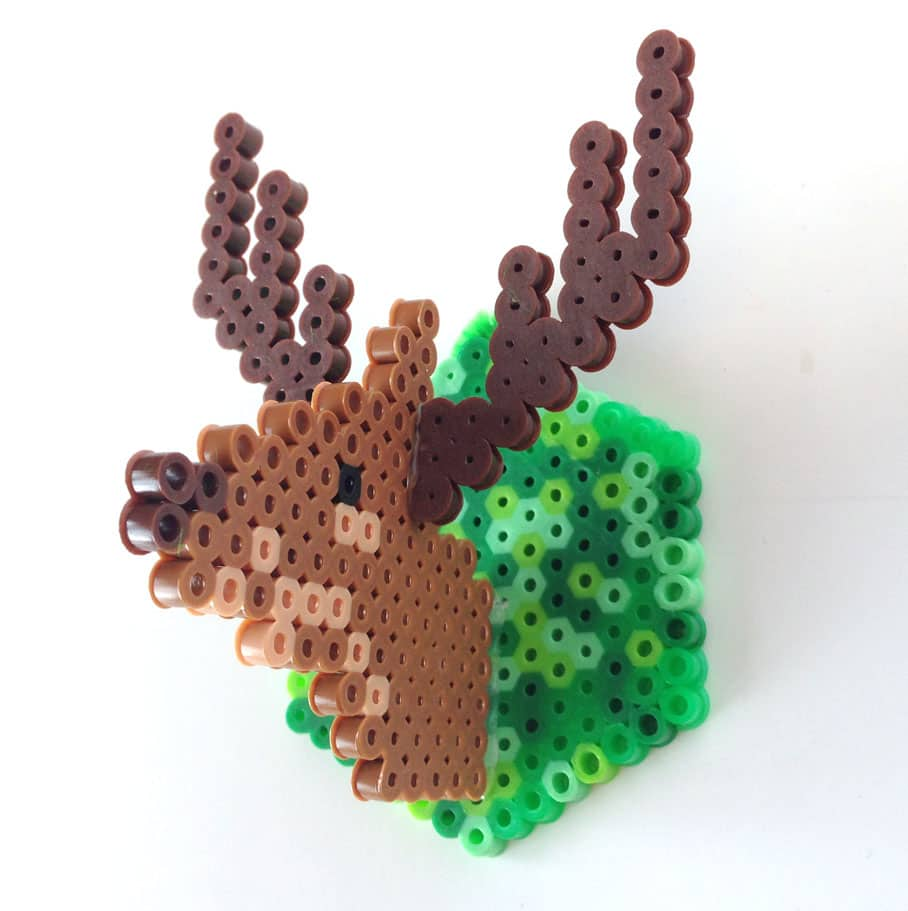 A deer ornament made out of fuse beads.