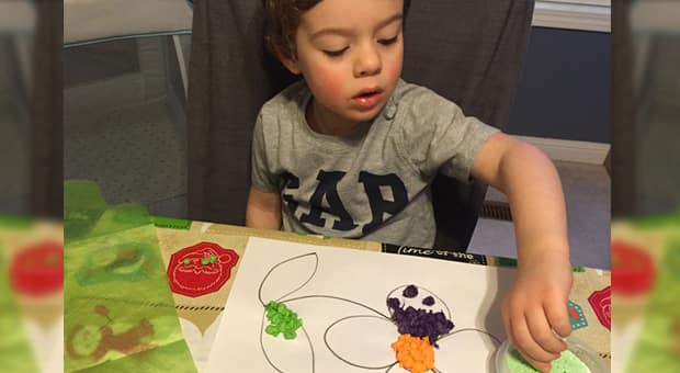 child making craft with tissue paper