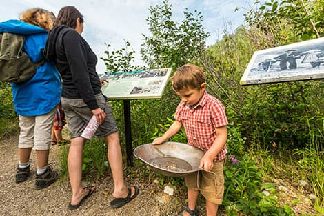 A child taking part in a gold-panning activity at Klondike National Historic Sites.