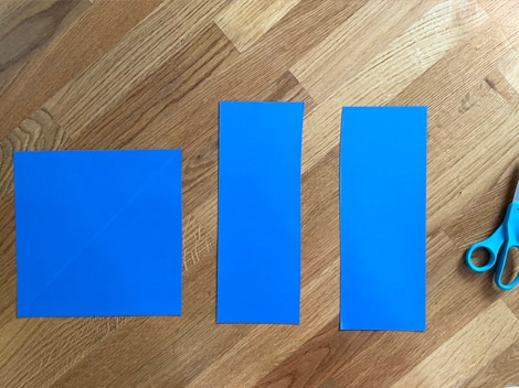 the square from the first cut piece of paper and the two rectangular pieces from folding the second piece of paper in half lengthwise and cutting down the middle