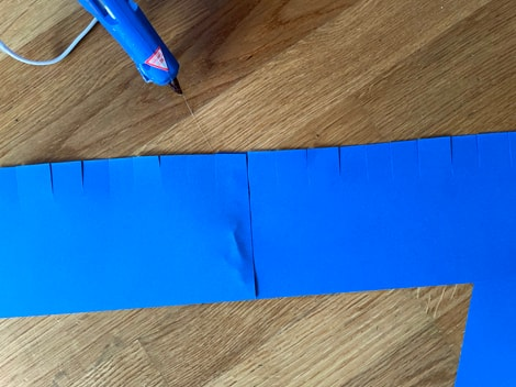 the two rectangle pieces glued together with the edge with slits on the same side for both