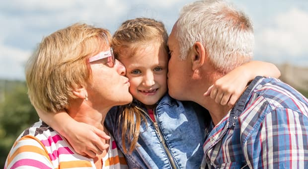 grandparents embrace their children before covid-19